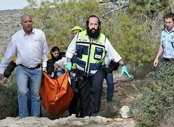 Israeli volunteers return with the body of Kristine Luken.