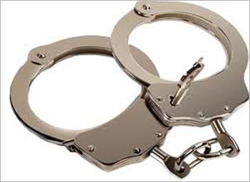 Police handcuff